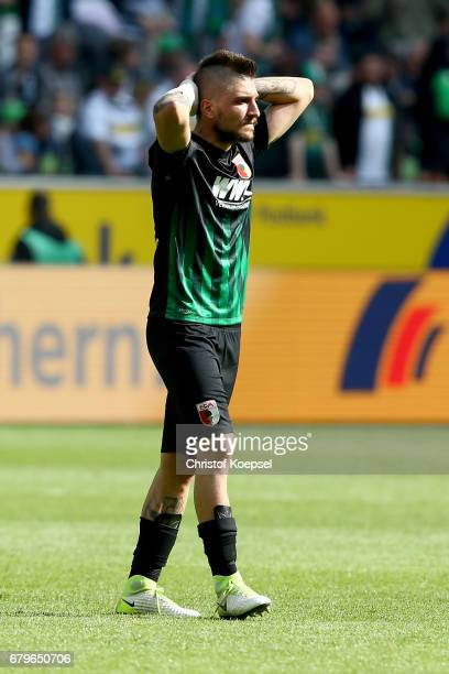 Konstantinos Stafylidis of Augsburg looks dejected after the Bundesliga match between Borussia Moenchengladbach and FC Augsburg at BorussiaPark on...