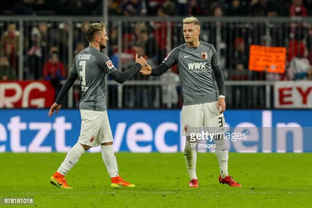 Konstantinos Stafylidis of Augsburg Philipp Max of Augsburg looks dejected during the Bundesliga match between FC Bayern Muenchen and FC Augsburg at...