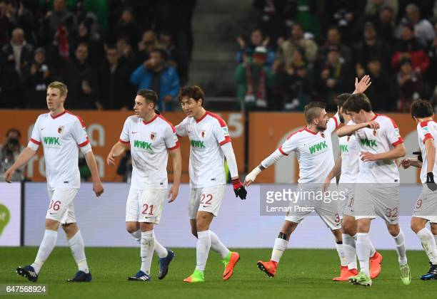 Konstantinos Stafylidis of FC Augsburg and his teammates celebrate their side's first goal during the Bundesliga match between FC Augsburg and RB...