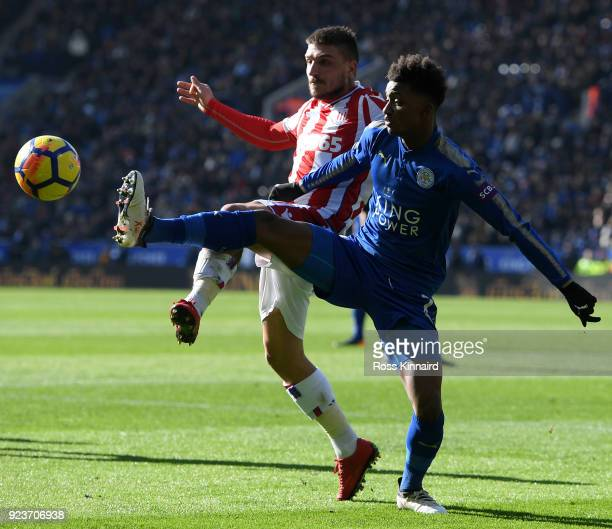 Konstantinos Stafylidis of Stoke City battles for possesion with Demarai Gray of Leicester City during the Premier League match between Leicester...