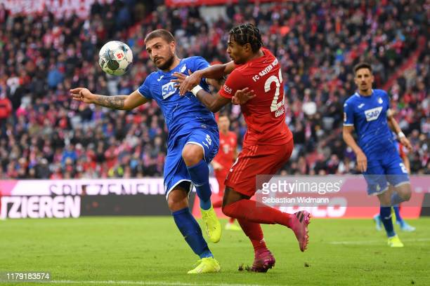 Konstantinos Stafylidis of TSG 1899 Hoffenheim is challenged by Serge Gnabry of FC Bayern Munich during the Bundesliga match between FC Bayern...