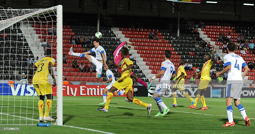 Konstantinos Triantafyllopolous (2nd L) of Greece leaps above the Mali defence during the FIFA U20 World Cup Group D match between Mali and Greece at Kamil Ocak Stadium on June 25, 2013 in Gaziantep, Turkey.