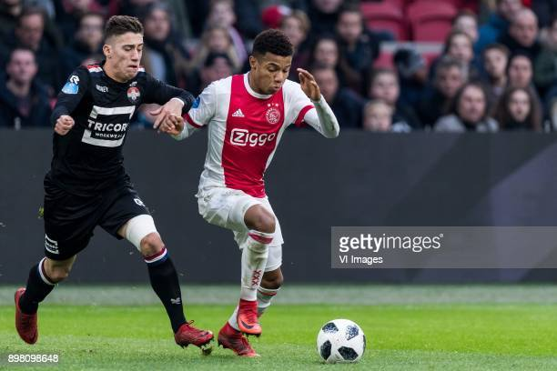 Konstantinos Tsimikas of Willem II David Neres of Ajax during the Dutch Eredivisie match between Ajax Amsterdam and Willem II Tilburg at the...