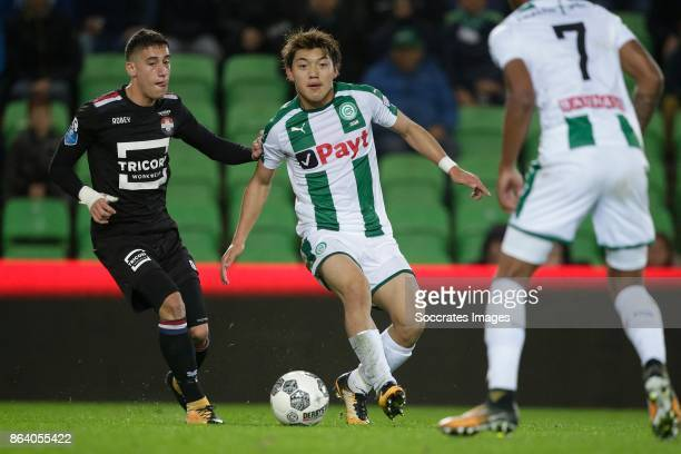 Konstantinos Tsimkas of Willem II Ritsu Doan of FC Groningen during the Dutch Eredivisie match between FC Groningen v Willem II at the Noordlease...