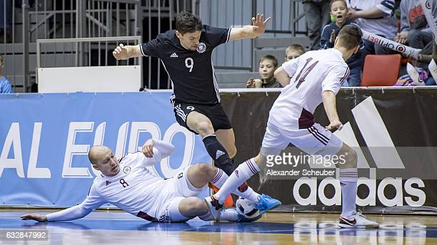Konstantins Zabraovskis of Latvia challenges Marc Philipp Nebgen of Germany during the UEFA Futsal European Championship Qualifying match between...