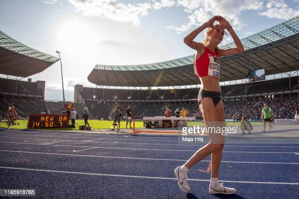 Konstanze Klosterhalfen celebrates after winning 5000m Women Final with a national record during German Athletics National Championship on August 03...