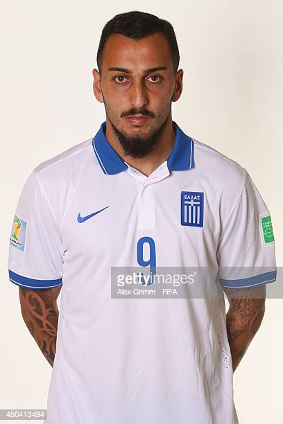Konstatinos Mitroglou of Greece poses during the official FIFA World Cup 2014 portrait session on June 10 2014 in Aracaju Brazil