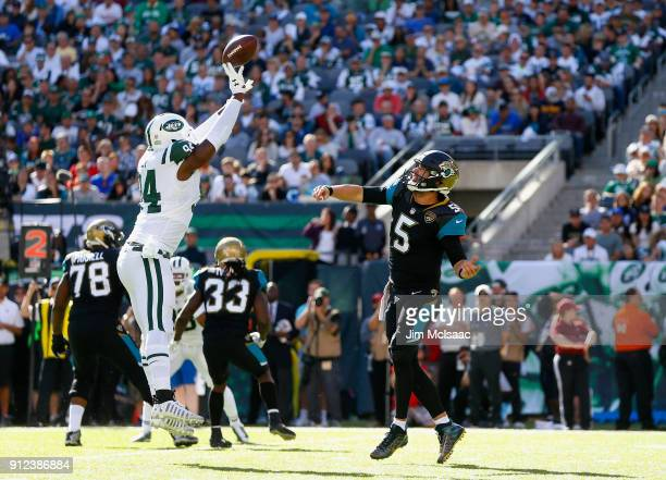 Kony Ealy of the New York Jets intercepts a pass against Blake Bortles of the Jacksonville Jaguars on October 1 2017 at MetLife Stadium in East...