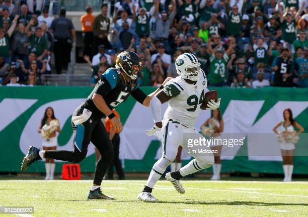 Kony Ealy of the New York Jets runs his interception against Blake Bortles of the Jacksonville Jaguars on October 1 2017 at MetLife Stadium in East...