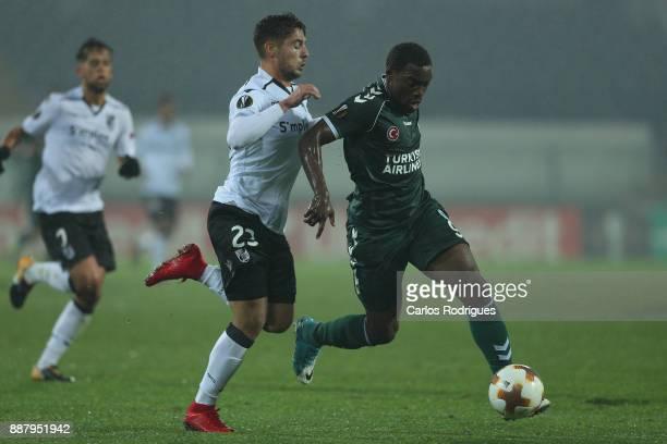 Konyaspor forward Malick Evouna from Gabon tries to escape Vitoria Guimaraes defender Joao Vigario from Portugal during the match between Vitoria...