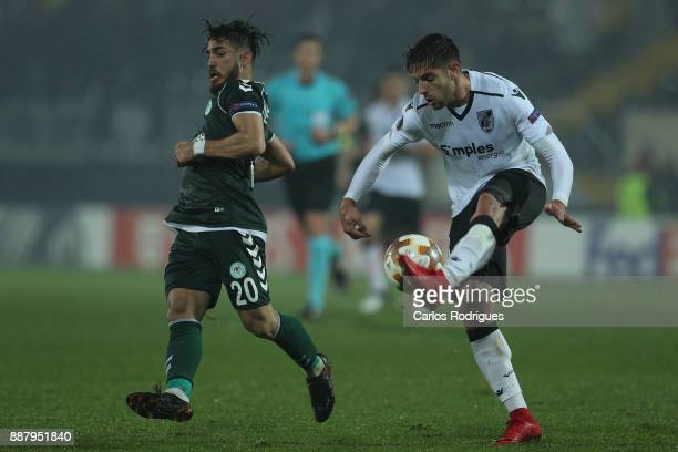 Konyaspor midfielder Vedat Bora from Turkey vies with Vitoria Guimaraes defender Joao Vigario from Portugal for the ball possession during the match...