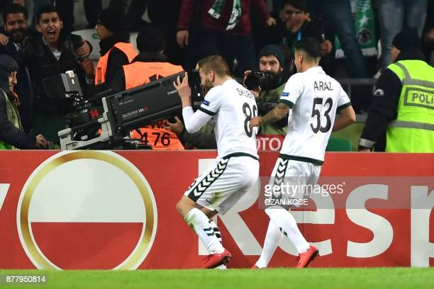 Konyaspor's Nejc Skubic celebrates with his team mates after scoring a goal during the UEFA Europa League Group I football match between Konyaspor...