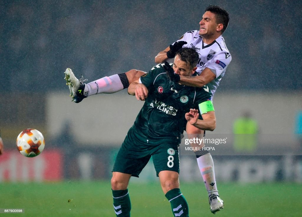 Konyaspor's Turkish midfielder Ali Camdali (L) challenges Vitoria Guimaraes' Colombian midfielder Guillermo Celis during the UEFA Europa League group I football match between Vitoria and Konyaspor in Guimaraes on December 7, 2017. /