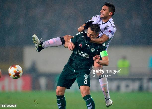 Konyaspor's Turkish midfielder Ali Camdali challenges Vitoria Guimaraes' Colombian midfielder Guillermo Celis during the UEFA Europa League group I...