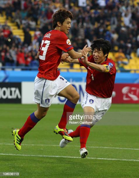 Koo Ja Cheol of Korea Republic celebrates his goal with teammate Park Ji Sung during the AFC Asian Cup Group C match between the Australian Socceroos...