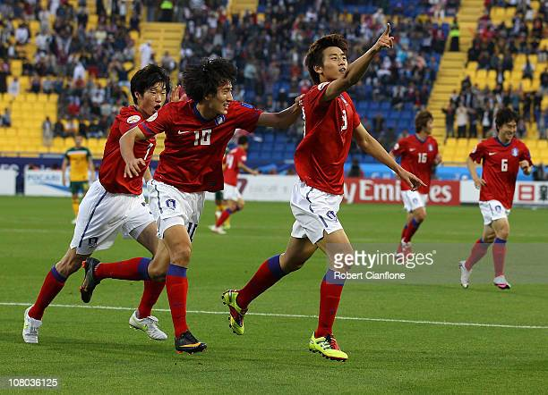 Koo Ja Cheol of Korea Republic celebrates his goal with teammates during the AFC Asian Cup Group C match between the Australian Socceroos and Korea...