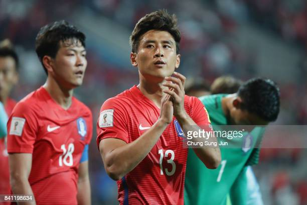 Koo Ja Cheol of South Korea applauds supporters after the scoreless draw in the FIFA World Cup Russia Asian qualifier match between South Korea and...