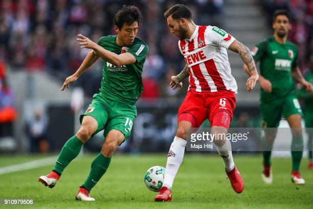 Koo JaCheol of Augsburg and Marco Hoger of 1FC Koeln battle for the ball during the Bundesliga match between 1 FC Koeln and FC Augsburg at...