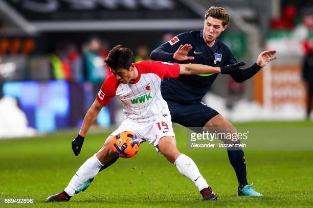 Koo JaCheol of Augsburg and Niklas Stark of Hertha Berlin battle for the ball during the Bundesliga match between FC Augsburg and Hertha BSC at...