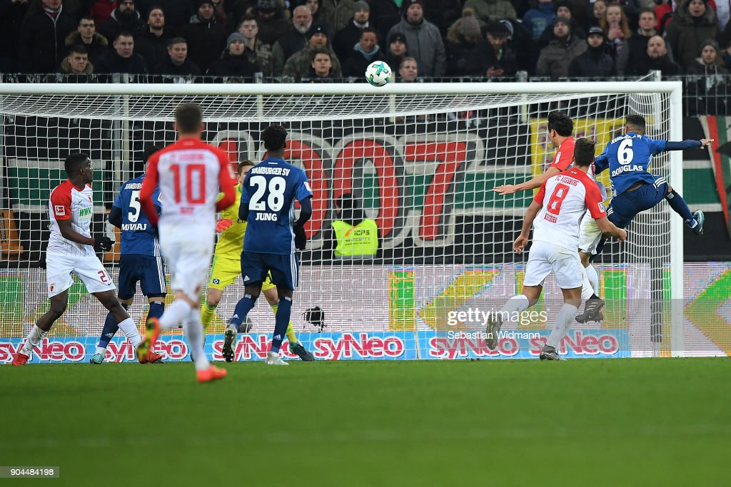 Koo Ja-cheol of Augsburg (3rd right) heads a goal to make it 1:0 during the Bundesliga match between FC Augsburg and Hamburger SV at WWK-Arena on January 13, 2018 in Augsburg, Germany.