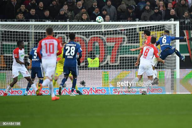 Koo Jacheol of Augsburg heads a goal to make it 10 during the Bundesliga match between FC Augsburg and Hamburger SV at WWKArena on January 13 2018 in...