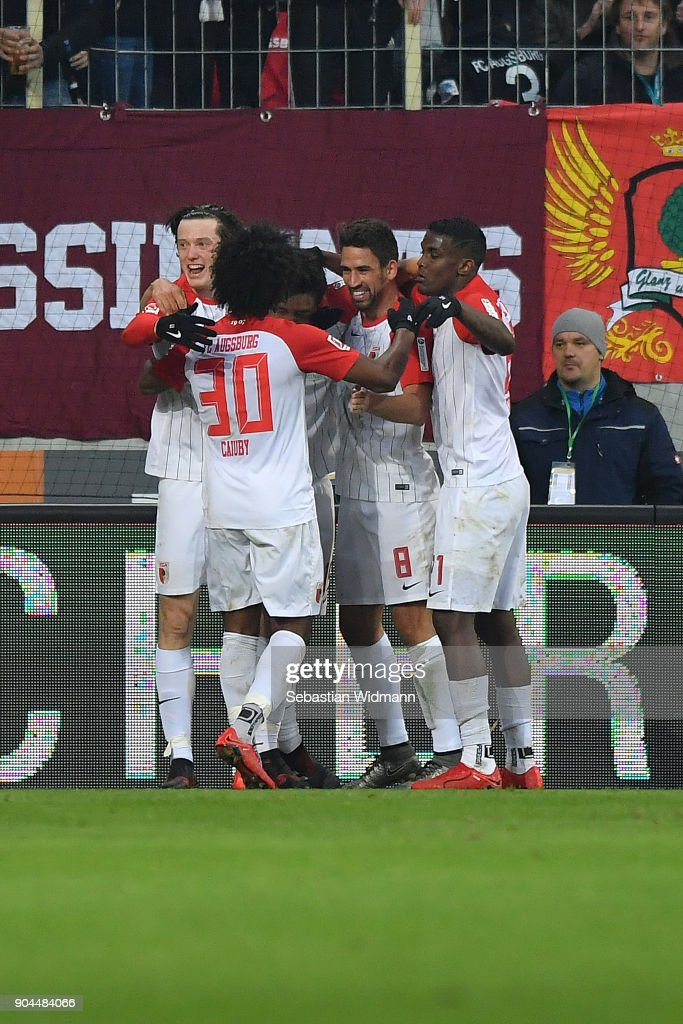 Koo Ja-cheol of Augsburg (3rd right) is celebrated by his team after he scored a goal to make it 1:0 during the Bundesliga match between FC Augsburg and Hamburger SV at WWK-Arena on January 13, 2018 in Augsburg, Germany.