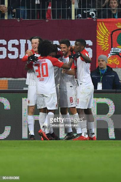 Koo Jacheol of Augsburg is celebrated by his team after he scored a goal to make it 10 during the Bundesliga match between FC Augsburg and Hamburger...