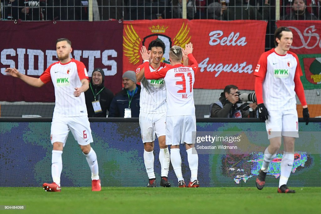 Koo Ja-cheol of Augsburg (2nd left) is celebrated by Philipp Max of Augsburg (31) after he scored a goal to make it 1:0 during the Bundesliga match between FC Augsburg and Hamburger SV at WWK-Arena on January 13, 2018 in Augsburg, Germany.