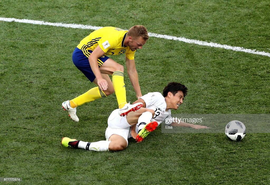 Koo Ja-Cheol of Korea Republic is tackled by Sebastian Larsson of Sweden during the 2018 FIFA World Cup Russia group F match between Sweden and Korea Republic at Nizhniy Novgorod Stadium on June 18, 2018 in Nizhniy Novgorod, Russia.