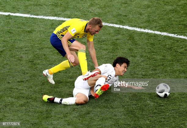 Koo JaCheol of Korea Republic is tackled by Sebastian Larsson of Sweden during the 2018 FIFA World Cup Russia group F match between Sweden and Korea...