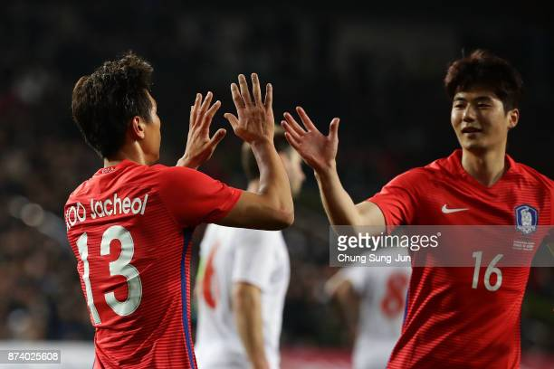 Koo JaCheol of South Korea celebrates with his team mate Ki SungYueng after first score during the international friendly match between South Korea...