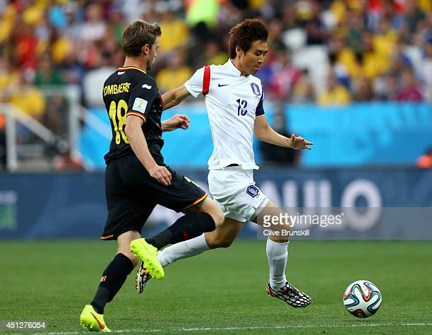 Koo JaCheol of South Korea controls the ball as Nicolas Lombaerts of Belgium gives chase during the 2014 FIFA World Cup Brazil Group H match between...