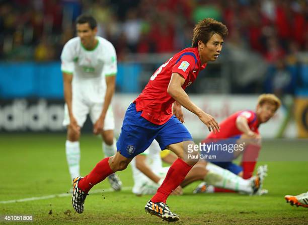 Koo JaCheol of South Korea reacts after scoring his team's second goal during the 2014 FIFA World Cup Brazil Group H match between South Korea and...
