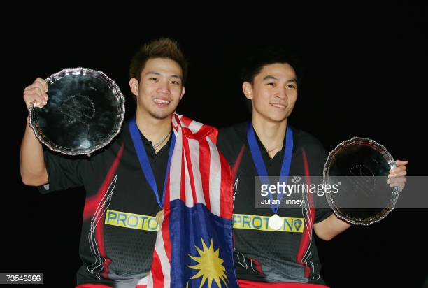 Koo Kien Keat and Tan Boon Heong of Malasia celebrate with their trophies after victory over Cai Yun and Fu Haifeng of China in the Men?s Doubles...