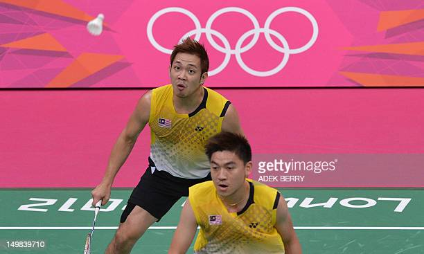 Koo Kien Keat of Malaysia eyes a shuttle cock next to his partner Tan Boon Heong during the bronze medal men's doubles badminton match against South...