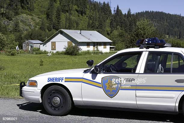 D' ALENE ID MAY 25 A Kootenai County Sheriff deputy watches over the home of Brenda K Groene May 25 2005 north of Coeur D' Alene Idaho Groene her son...