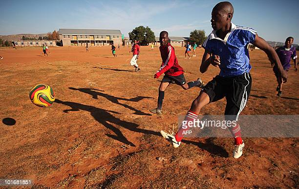 Kopano Thebe looks on as his brother Thetso Thebe shoots a ball during a friendly match in the village of Maqhaka in Maseru, Lesotho on May 26, 2010....