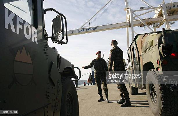 Soldiers of the 10th motorized battalion of the Slovenian Army load vehicles and weaponry on a cargo ship at Koper harbour 14 February 2007 before...