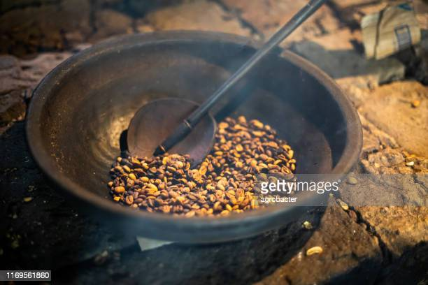 kopi luwak coffee beans in indonesian coffee roastery - civet cat stock pictures, royalty-free photos & images
