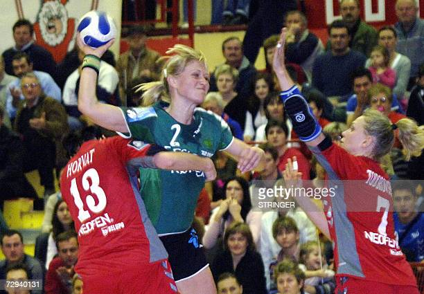 Viborg's Ehadsen Skov Rikke tries to score between Podravka Vegeta's Lidija Horvat and atalia Todorovska during their Champion league match in...