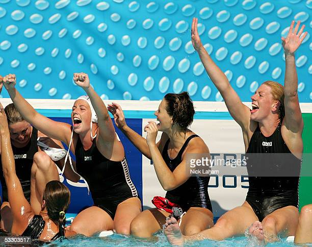 Kora Kisteleki Patricia Horvath and Orsolya Takacs of Hungary celebrate after defeating the United States in the gold medal match during the XI FINA...