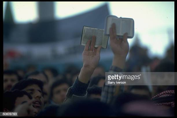 Korans held aloft by members of Muslim Brotherhood joining in mass proIraqi demo as outbreak of gulf war appears imminent
