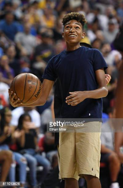 Koraun Mayweather son of boxer Floyd Mayweather Jr shoots baskets as part of a promotion during a timeout in a 2017 Summer League game between the...
