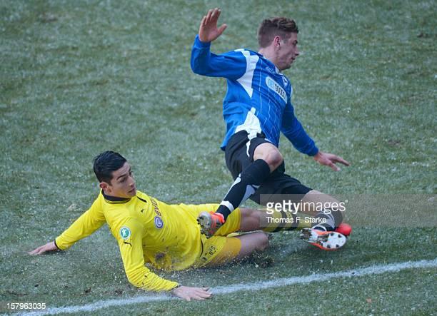 Koray Guenter of Dortmund tackles Johannes Rahn of Bielefeld during the Third League match between Arminia Bielefeld and Borussia Dortmund II at...