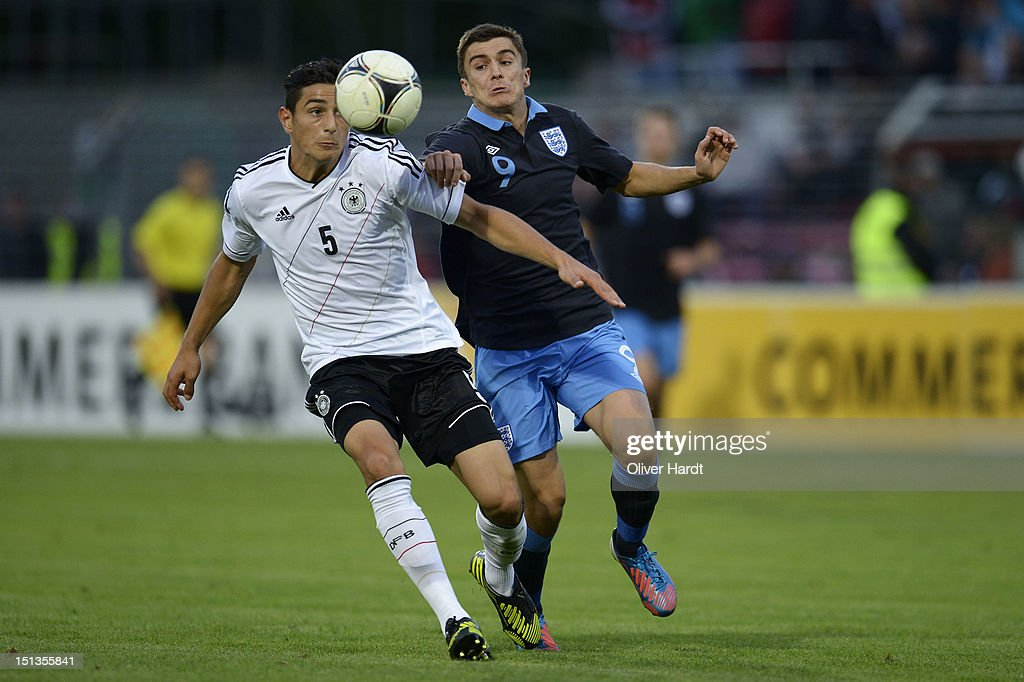 Koray Guenter (L) of Germany and Adam Morgan (R) of England battle for the ball during the Under 19 international friendly match between Germany and England at Stadion an der Lohmuehle on September 6, 2012 in Luebeck, Germany.