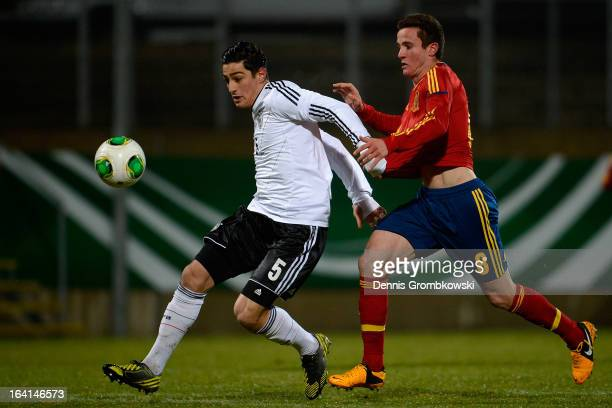 Koray Guenter of Germany is challenged by Saul Niguez of Spain during the International Friendly match between U19 Germany and U19 Spain on March 20...
