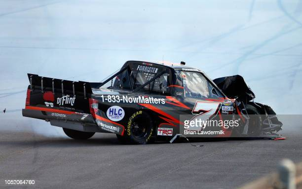 Korbin Forrister driver of the TruClear Toyota is involved in an ontrack incident during the NASCAR Camping World Truck Series Fr8Auctions 250 at...