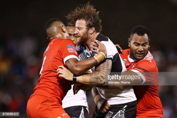 Korbin Sims of Fiji is tackled by the Tongan defence during the 2017 Pacific Test Invitational match between Tonga and Fiji at Campbelltown Sports...