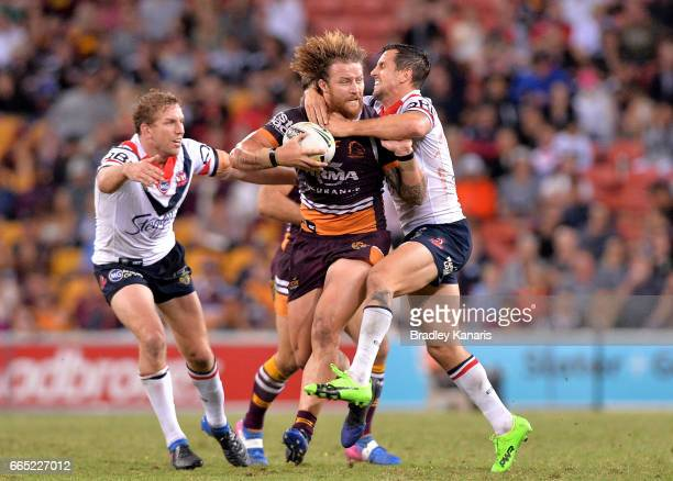 Korbin Sims of the Broncos attempts to breaks away from the defence during the round six NRL match between the Brisbane Broncos and the Sydney...