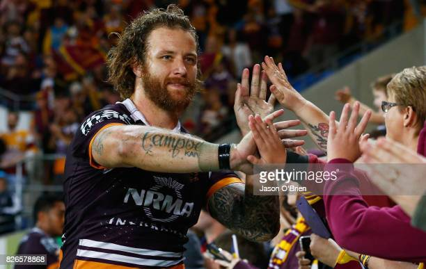 Korbin Sims of the Broncos celebrates with fans during the round 22 NRL match between the Gold Coast Titans and the Brisbane Broncos at Cbus Super...